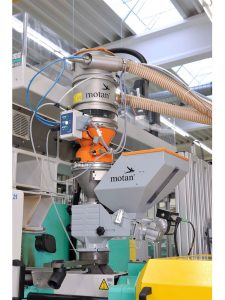 Implosion: Material loader with integrated filter and implosion cleaning