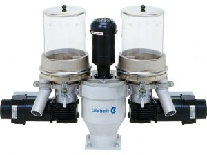Volumetric dosing unit for two components